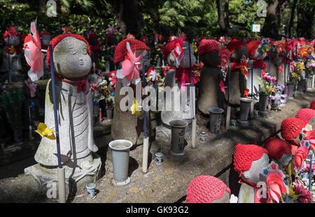 Jizo statues at Unborn Children Garden, Zojoji Temple, Tokyo, Japan - Stock Photo