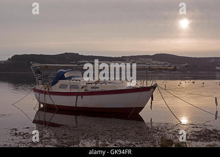 Moored small boat on a Winters morning on the Beauly Firth, Inverness-shire, Highland Region Scotland.  SCO 11,170. - Stock Photo