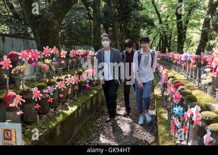 Visitors at Unborn Children Garden, Zojoji Temple, Tokyo, Japan - Stock Photo