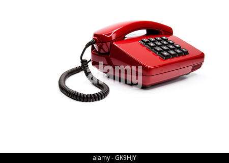 classic red telephone from the eighties - Stock Photo