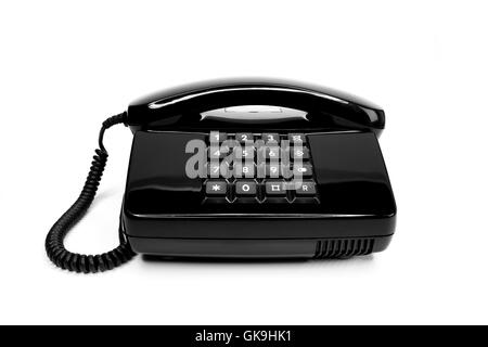 classic black telephone from the eighties - Stock Photo