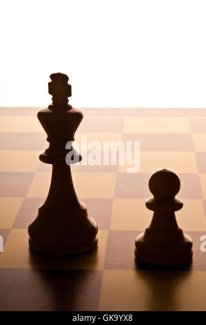 chess King and Pawn on the chessboard - Stock Photo