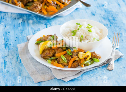 Chicken stir fry with bell peppers and green beans in lemon glaze. Asian style chicken on plate, selective focus, - Stock Photo