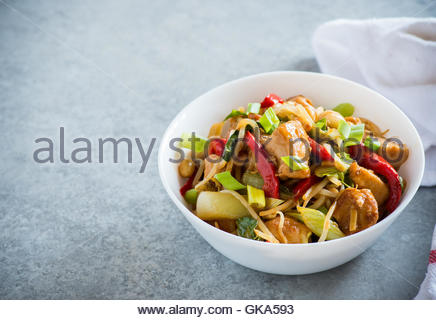 Chicken stir fry with bell peppers, bean sprouts and bok choy in a bowl. Chicken kung pao with vegetables, selective - Stock Photo