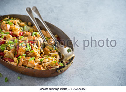 Chicken stir fry with bell peppers, bean sprouts and bok choy in vintage pot. Chicken kung pao with vegetables, - Stock Photo