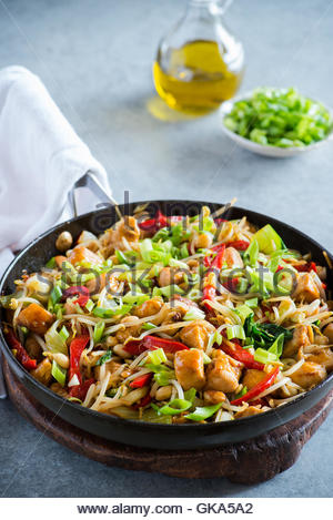 Chicken stir fry with bell peppers, bean sprouts and bok choy in frying pan. Chicken kung pao with vegetables, selective - Stock Photo