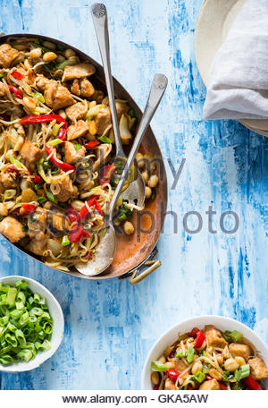Chicken stir fry with bell peppers, bean sprouts and bok choy in frying pan. Chicken kung pao with vegetables, top - Stock Photo