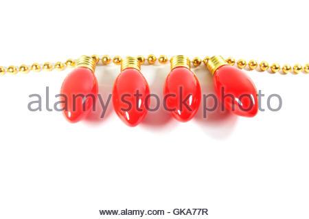 christmas light bulbs on a strand of garland beads stock photo
