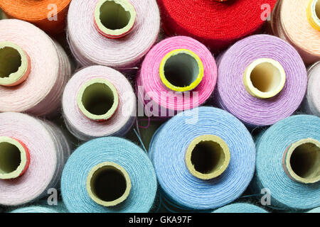 colored cotton reels - Stock Photo