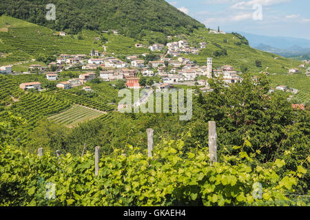Small italian town Valdobbiadene, surrounded by vineyards, zone of production of traditional italian white sparkling - Stock Photo