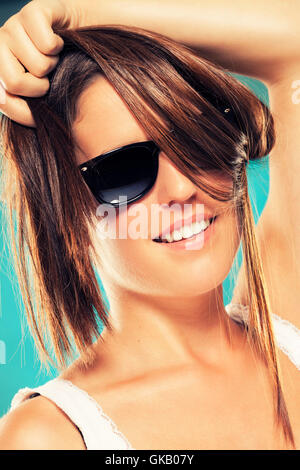 young woman wearing sunglasses - Stock Photo