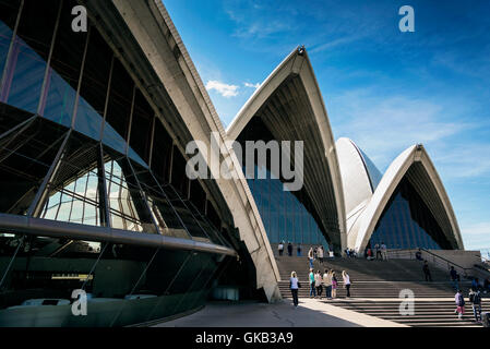 tourists visiting sydney opera house landmark detail in australia on sunny day - Stock Photo