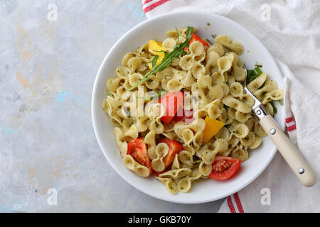 Pasta with cherry tomatoes in bowl, food top view - Stock Photo