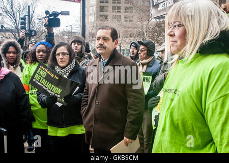 Chicago, Illinois - November 28, 2014: Jesus Chuy Garcia supports striking Walmart workers as they protest outside - Stock Photo
