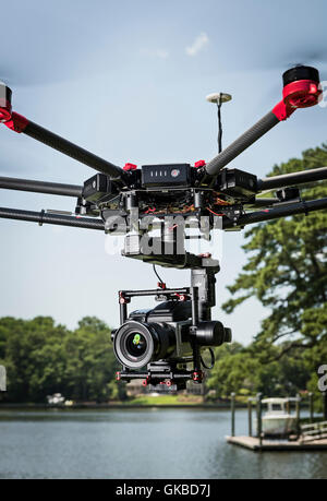 DJI Matrice 600 drone flying with Hasselblad on Ronin Gimbal - Stock Photo