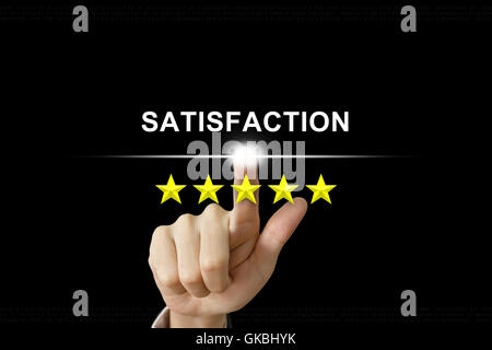 business hand clicking satisfaction with five stars on screen - Stock Photo