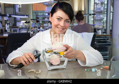 zahntechnikerin in a dental laboratory with dentures. - Stock Photo