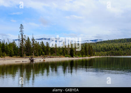 Redfish Lake with a view of the snow covered mountains at Redfish Lake, Sawtooth National Forest, Idaho - Stock Photo