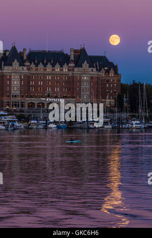 Empress hotel and Inner harbor with full moon rising-Victoria, British Columbia, Canada. - Stock Photo
