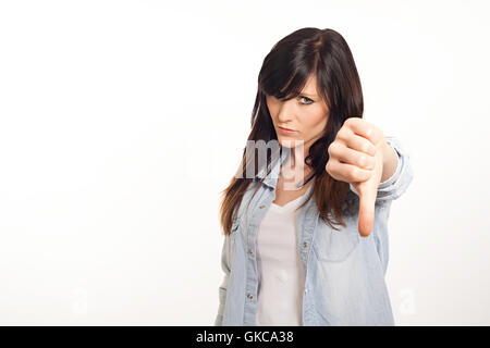 portrait of a beautiful young woman thumbs down - Stock Photo