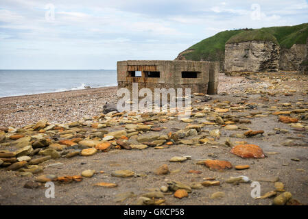 Ruined remains of a World War II concrete pillbox on Blast Beach, Nose's Point, Dawdon, Seaham, County Durham, UK - Stock Photo