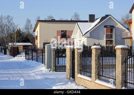 VILNIUS, LITHUANIA - JANUARY 02 23, 2016: The frozen northern modern Pilaite village  near Lithuanian capital. The - Stock Photo