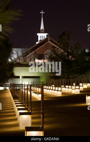 The Oklahoma City Bombing Memorial at night with 1st Methodist Church in the back. The church was badly damaged - Stock Photo