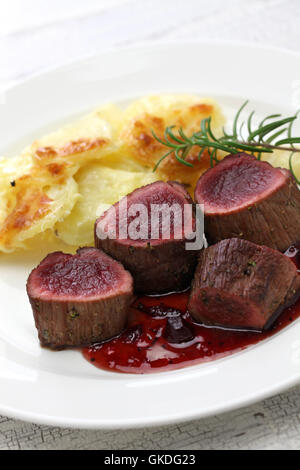 venison steak with creamy baked potato - Stock Photo