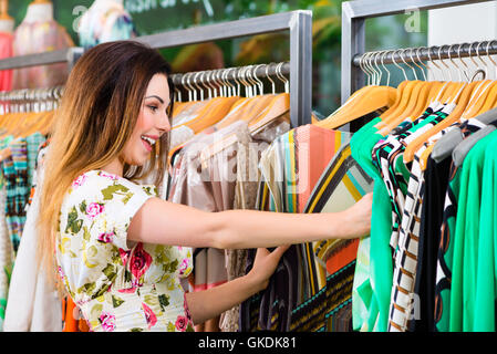 young woman shopping in store or boutique - Stock Photo