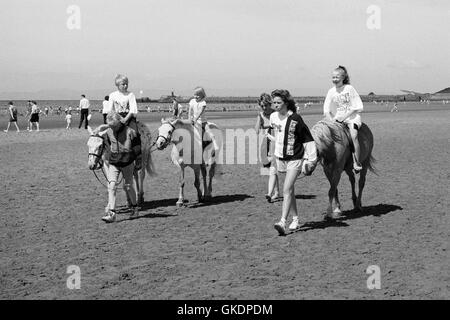 Donkey rides on the beach at Ayr, 1990 - Stock Photo