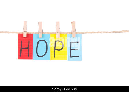 Hope, Colorful words hang on rope - Stock Photo