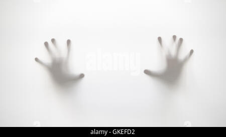 Silhouette of hands behind curtain with soft focus and blur - Stock Photo