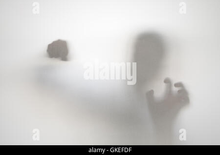 Angry man behind curtain. Hands and blurry human figure abstraction. - Stock Photo