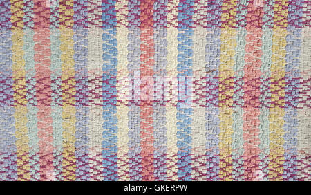 Close up of woven plaid rug pattern. - Stock Photo