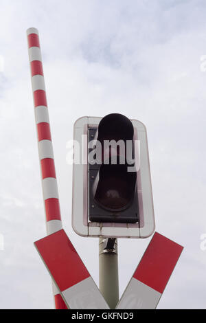 Railroad crossing signal light and open bar - Stock Photo