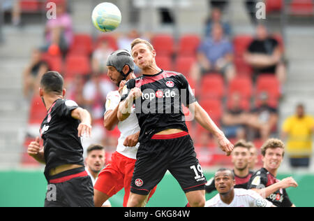 Halle's Klaus Gjasula (l.) and Kaiserslautern's Marcel Gaus in action during the DFB Cup soccer match between Hallescher - Stock Photo