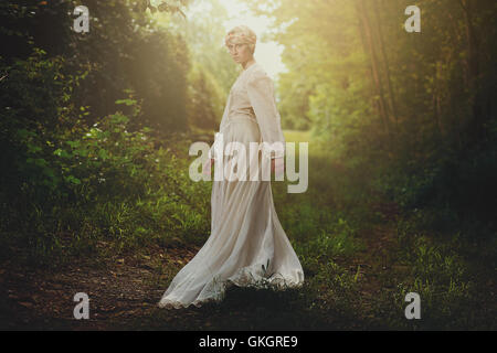 Beautiful fair girl in dreamy woods. Fantasy and surreal - Stock Photo