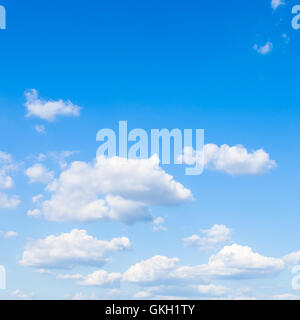 small white clouds in blue sky in sunny summer day - Stock Photo