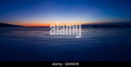 Dawn on an icy Lake Baikal panorama long - Stock Photo