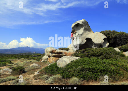 Bouldering at Pianotolli-Caldarello on the coast in Southern Corsica, France - Stock Photo