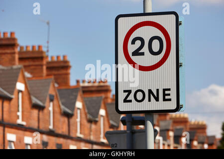 20 mph zone in a residential street with onstreet parking in terraced streets in the uk - Stock Photo