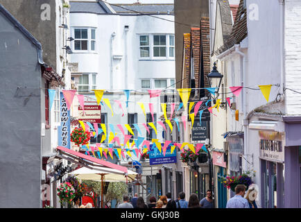 The Lanes, Brighton, East Sussex, UK with shop, restaurant and cafe signs and colourful bunting - Stock Photo
