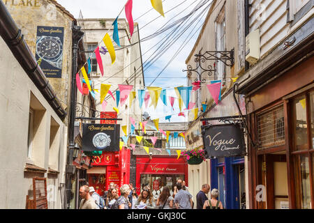 Shop signs and colourful bunting in The Lanes, Brighton, East Sussex, UK on a sunny summer day - Stock Photo