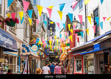 Street scene with colourful bunting and shop signs in The Lanes, Brighton, East Sussex, UK - Stock Photo