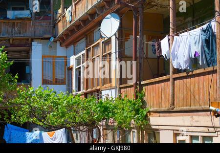 Poor old Georgian yard in Tbilisi city. Georgia - Stock Photo