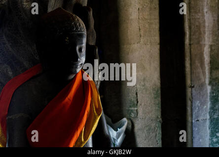 buddha statue in angkor wat landmark famous buddhist temples in siem reap cambodia asia - Stock Photo