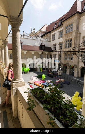 Weekend activities for the community in the inner courtyard of the Old town Hall in Bratislava Old Town in Slovakia - Stock Photo