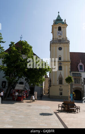 The tower of the old town hall in Bratislava old town with its main square, Hlavné námestie, ( Hlavné square) in - Stock Photo