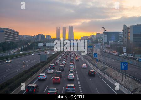 Traffic jam in A-1 motorway at dusk. Madrid, Spain. - Stock Photo