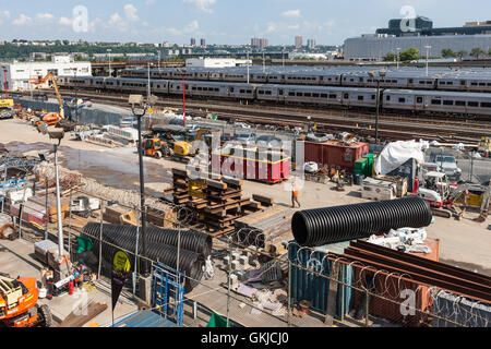 A construction staging area sits adjacent to the tracks in support of the new Hudson Yards development in New York - Stock Photo